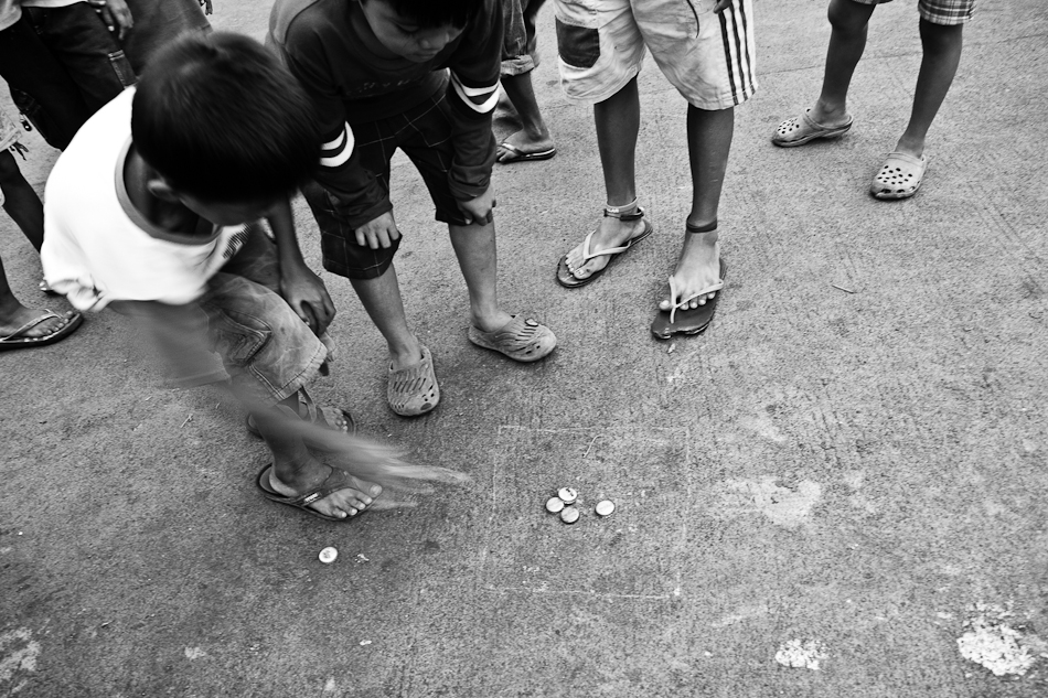 children playing a game using bottle caps