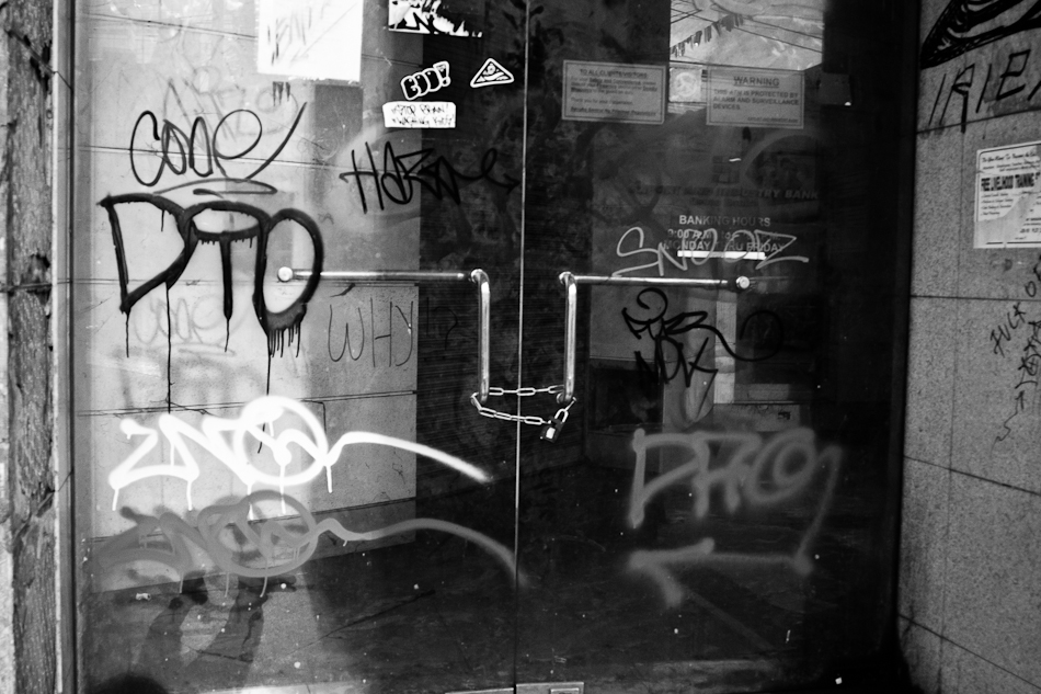 glass doors heavily painted with graffiti.