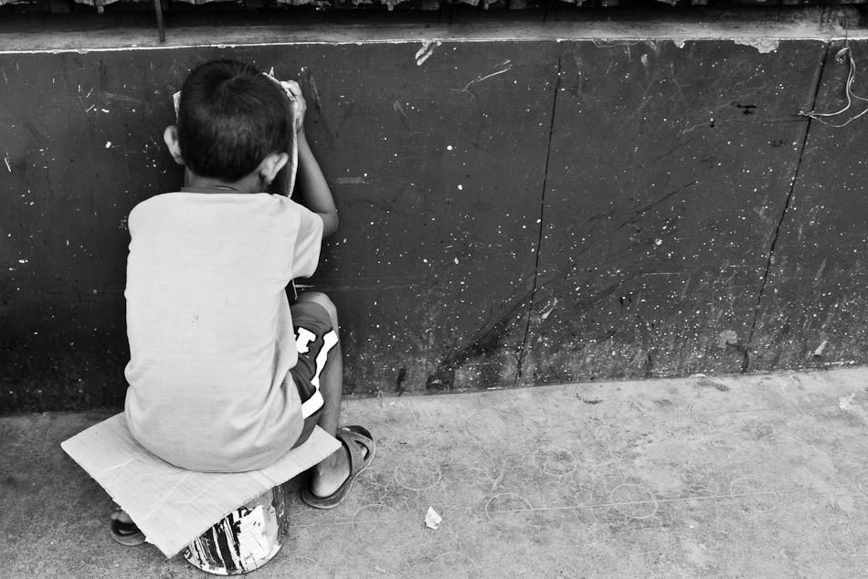 little boy facing the wall
