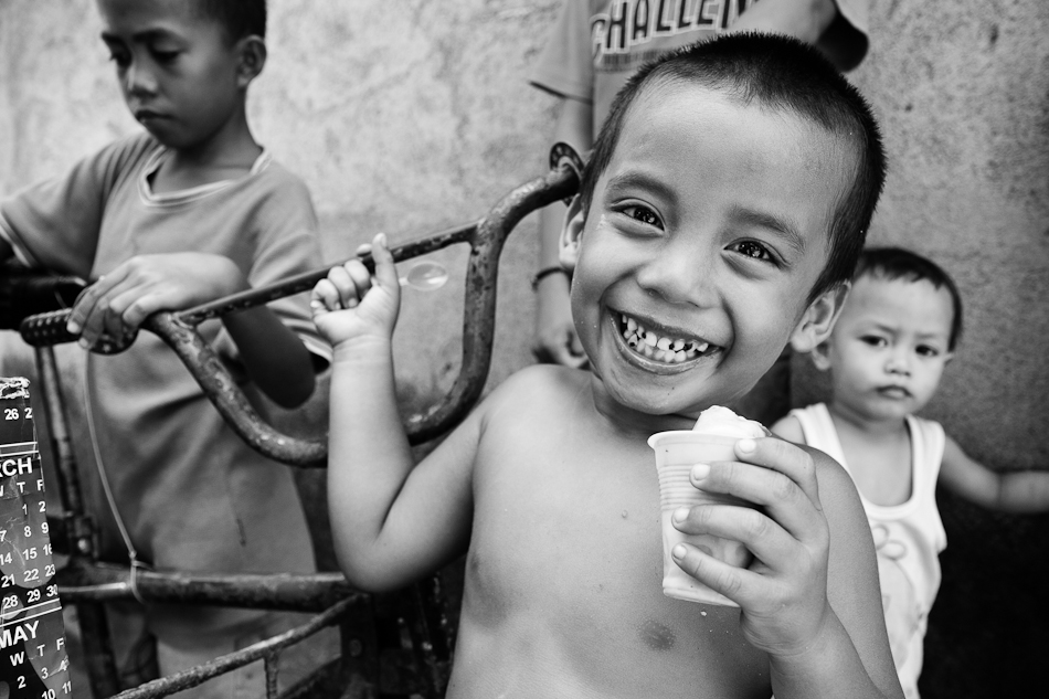 all smiles as this little boy gets his share of ice cream in the morning