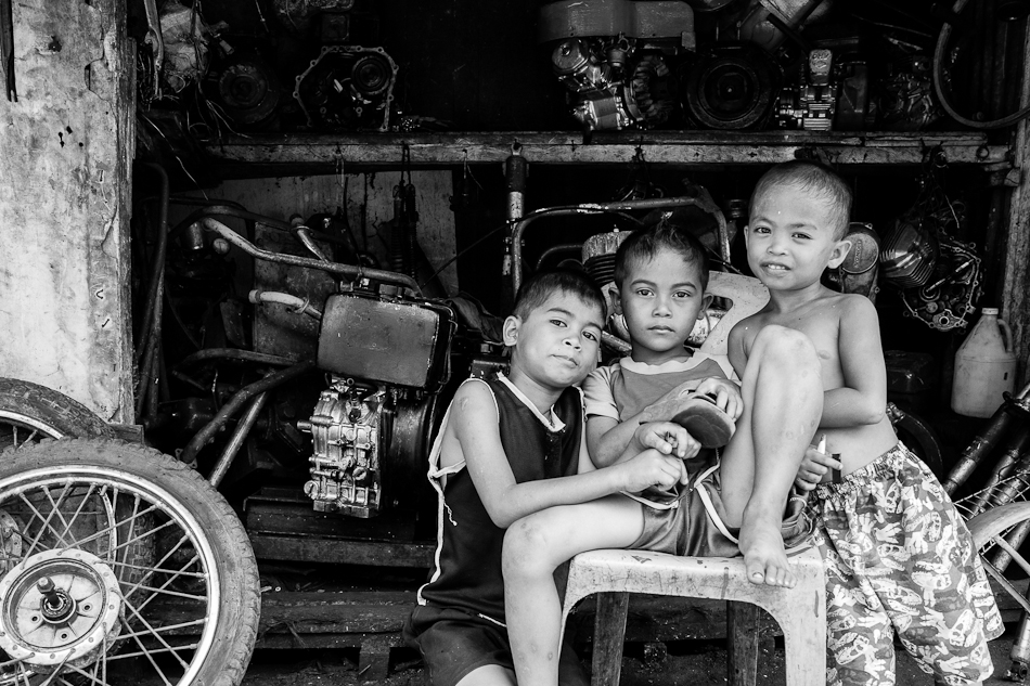 kids minding a junk shop selling motorcycle and generator parts
