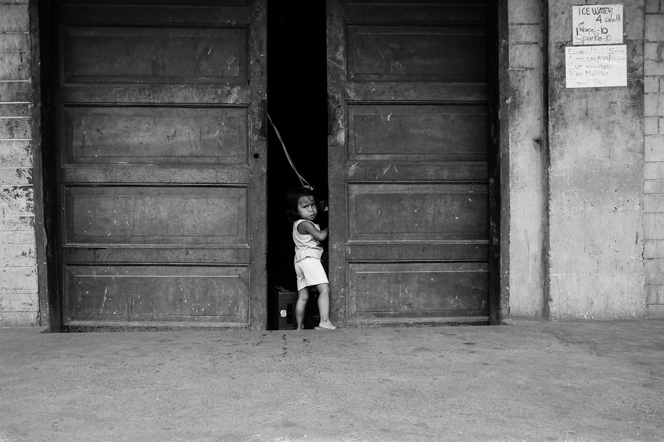a little girl standing by the door