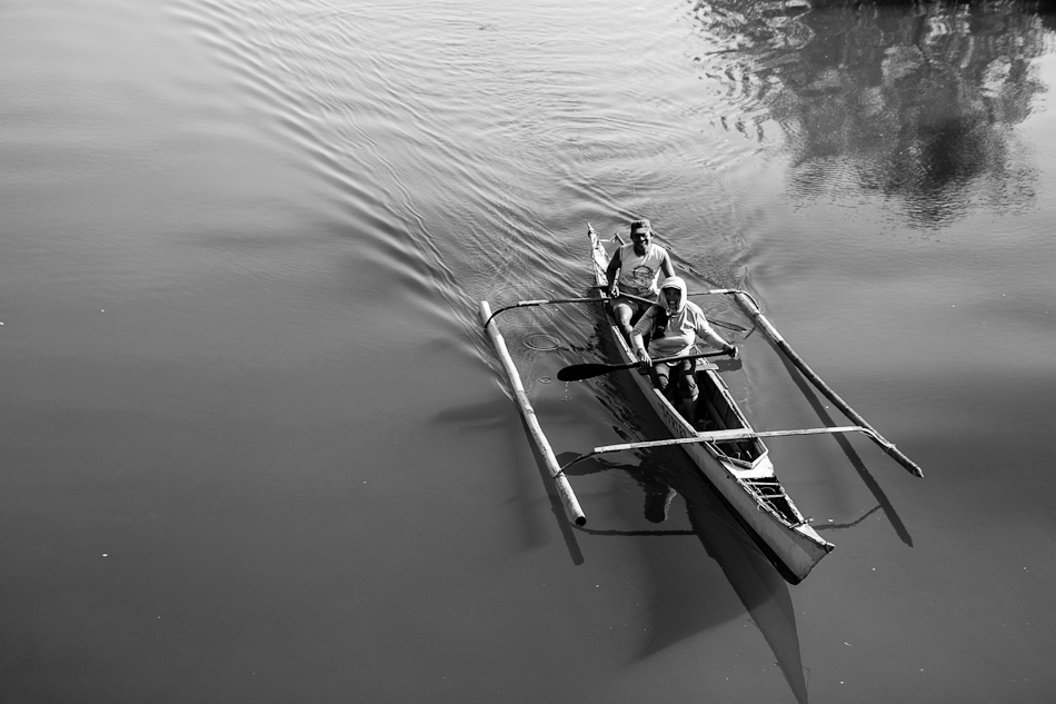 close up photo of couple in a rowboat