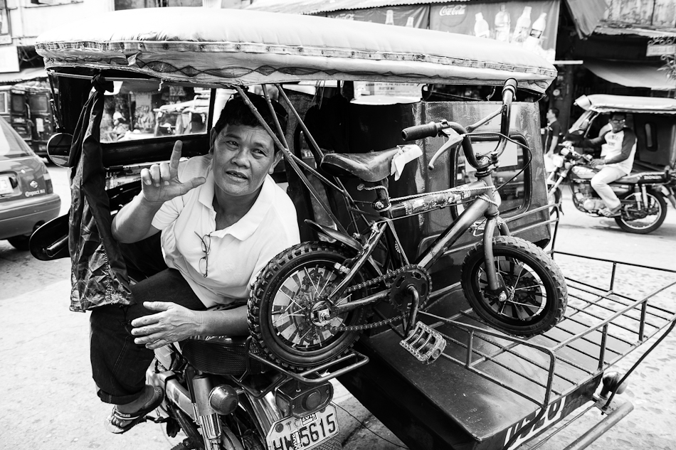 tricycle driver with a spare bike