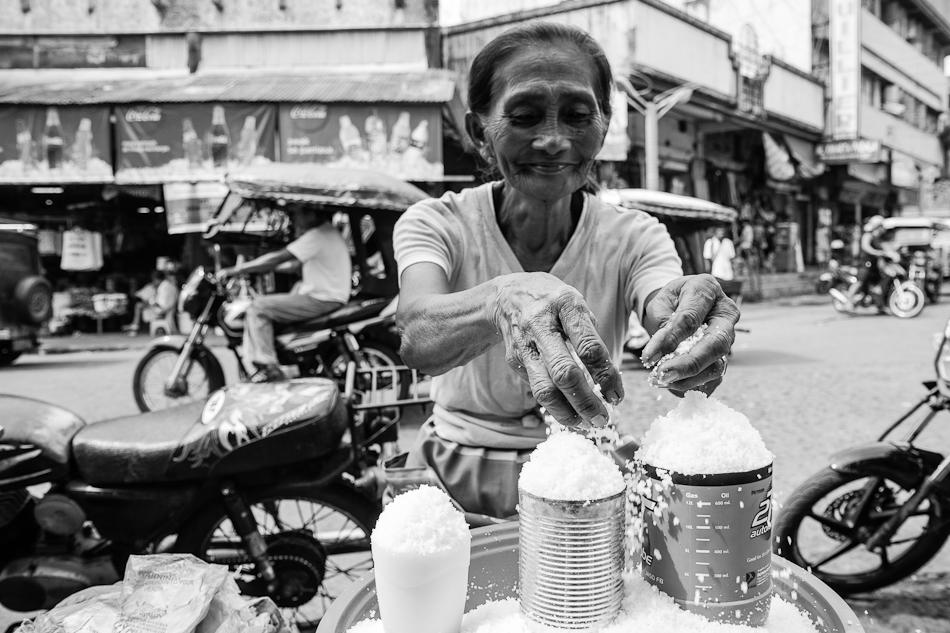 a salt vendor on the market sidewalk