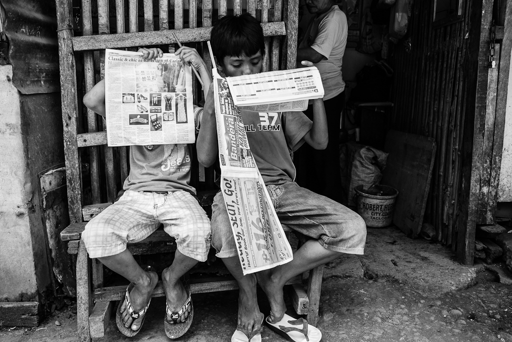 boys reading the early morning paper