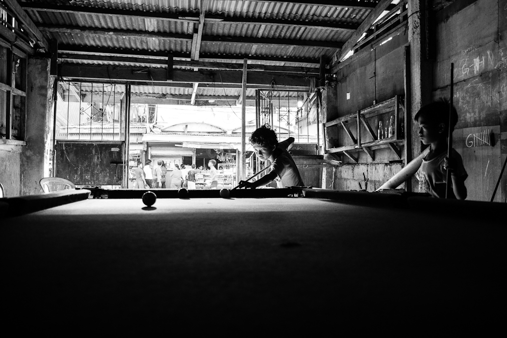 boys playing billiards