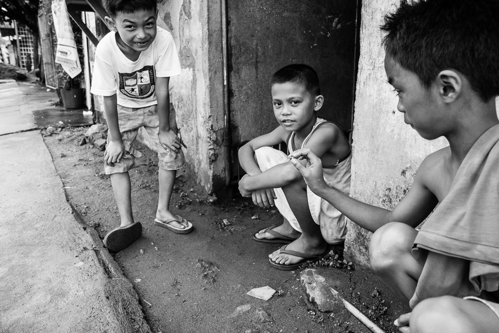 boys playing marbles
